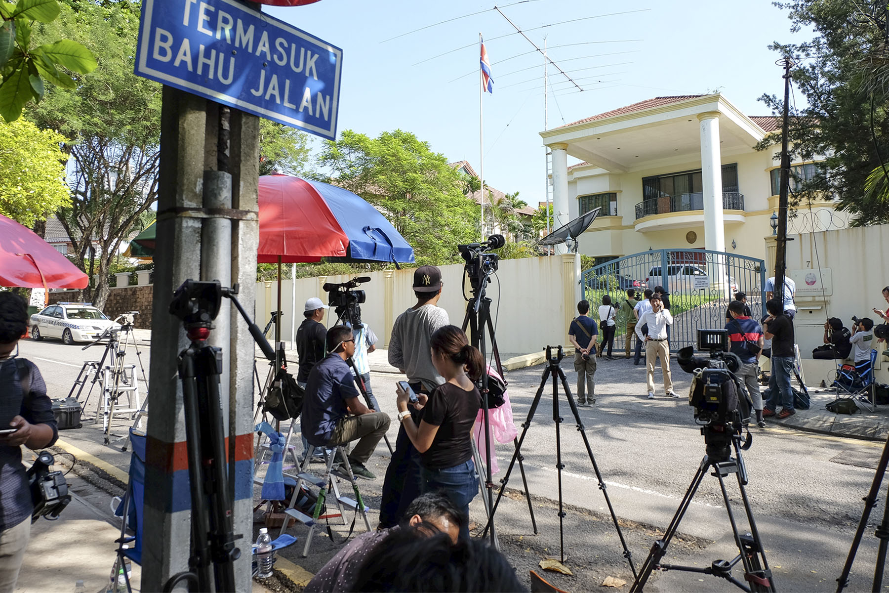 Members of the media gather in front of the North Korean embassy in Damansara Heights, Kuala Lumpur. - Picture by Yusof Mat Isa
