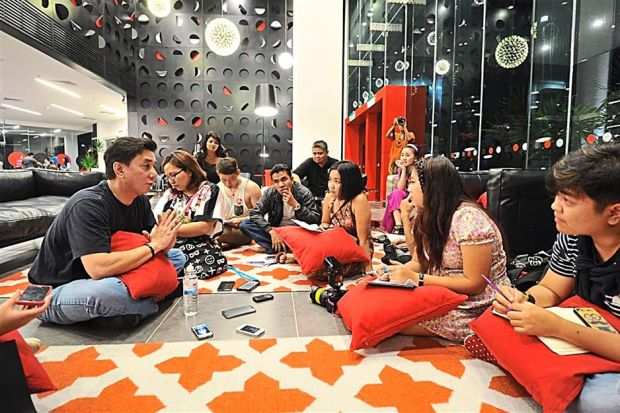 Sharing travel tales: Guests at the Tune Hotel klia2 Pyjama Party.