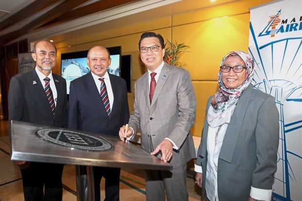 On cloud nine: (From left) Malaysia Airports senior general manager Zainol Mohd Isa, Malaysia Airports chairman Tan Sri Syed Anwar Jamalullail, Liow and Dr Puteri Shireen at the presentation of klia2 Gold LEED certificate in klia2.
