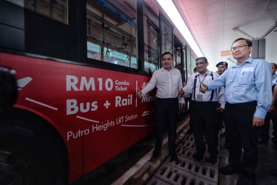 Transport Minister Anthony Loke (left) strikes a pose during the launch of the new KLIA, klia2 shuttle bus service at the Putra Heights LRT Station March 7, 2019. — Picture by Shafwan Zaidon