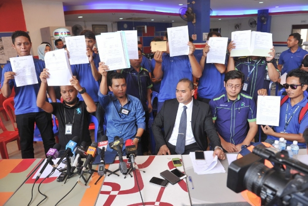 Rayani Air's klia2 station manager, Zulkalnain Azdan (seated second left) and other staff hold a press conference on the issue of salary arrears, in Bandar Baru Salak Tinggi, April 22, 2016. Also present is Zaflee Pakwanteh, the lawyer representing the workers involved. — Bernama pic