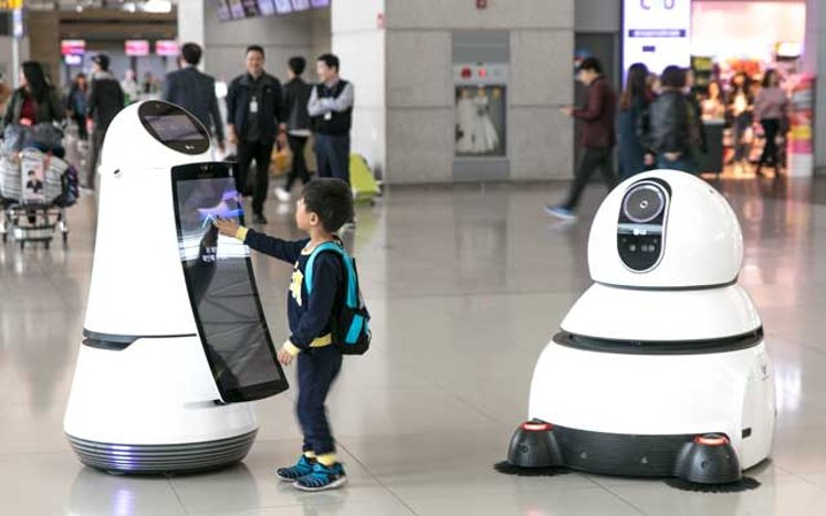 A boy interacts with Incheon International Airport's Chatbot