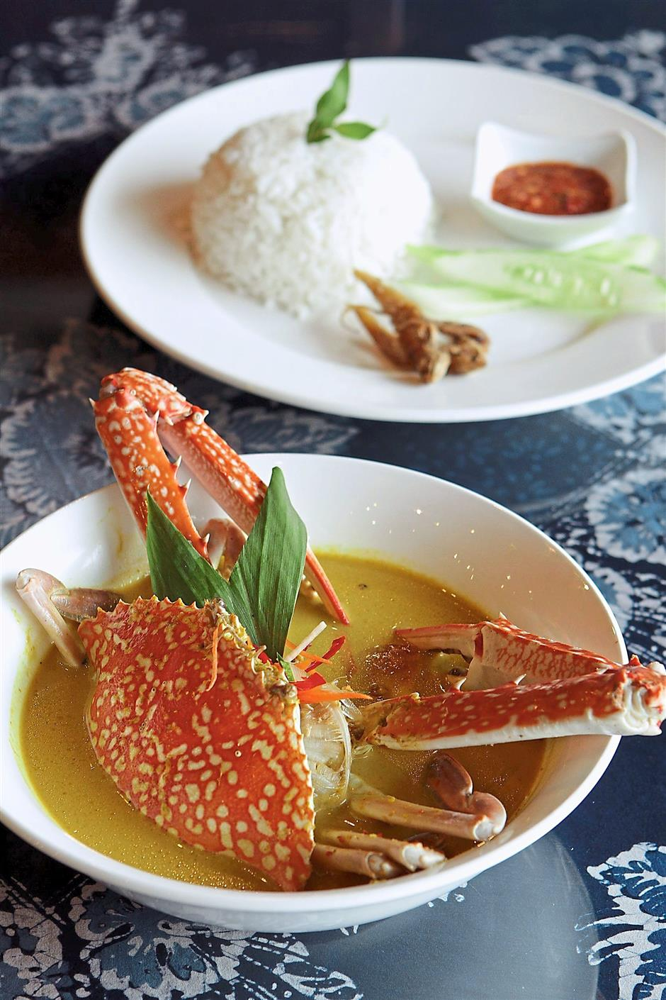 This dish might look tame but sure packs a punch with cili padi heat and soft, sweet crab meat.