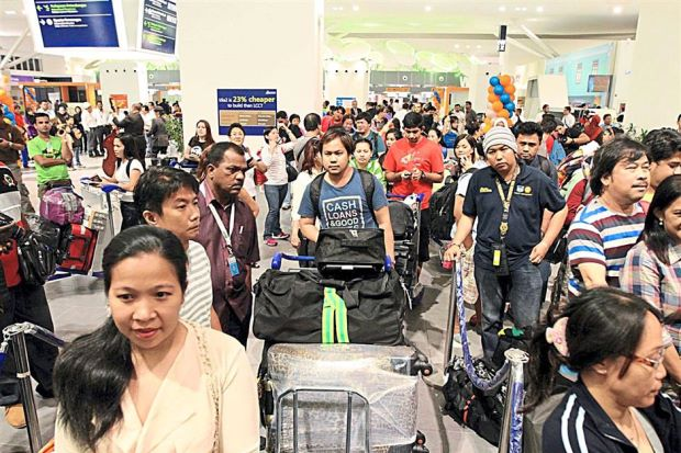 Waiting to check in: A busy scene at klia2 after the new airport opened on Thursday. Many Malaysians, according to a senior insurance agency manager, have the wrong perception that travel insurance is redundant.