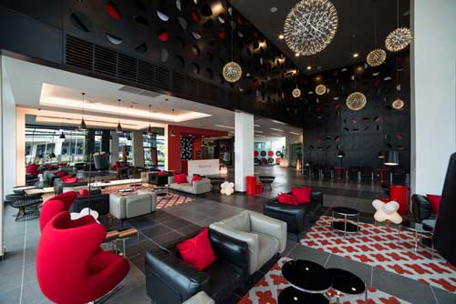 The spacious and tastefully designed lobby is the first of its kind in the Tune Hotels chain