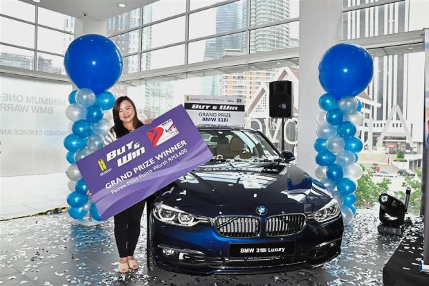 Tan with her brand new BMW 318i during the prize-giving ceremony for the Eraman Shopping Extravaganza - Buy & Win Contest.
