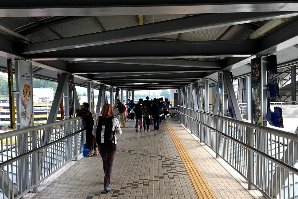 Passengers walking on the pedestrian bridge