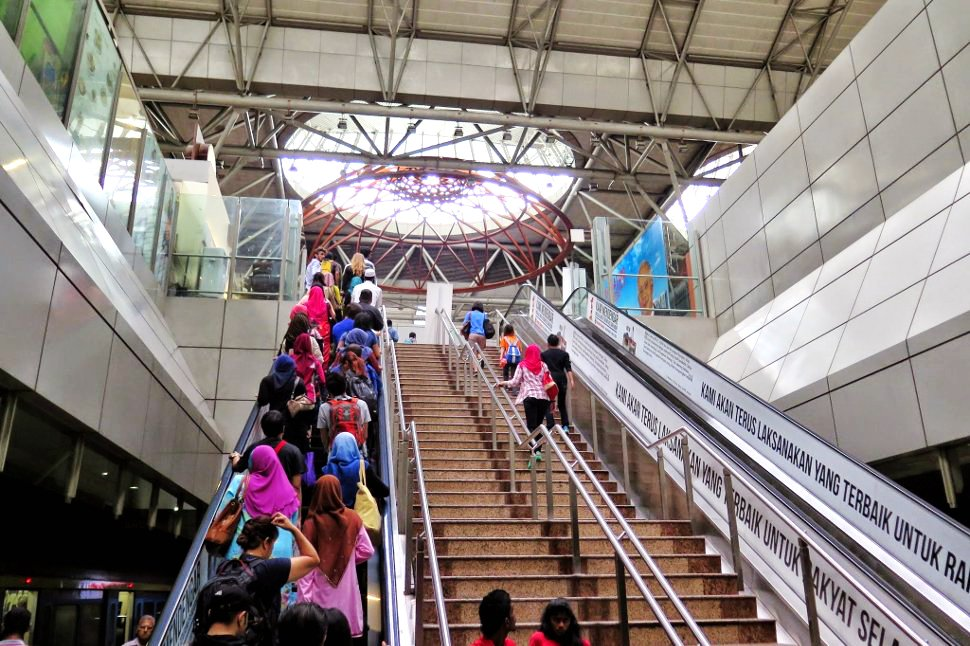 Passengers exiting plaftforms of KL Sentral KTM station to KL Sentral