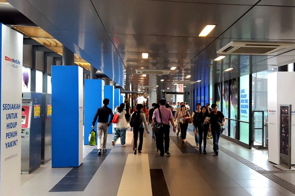 Commuters walking toward the station from Nu Sentral