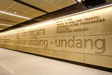 Wall featuring text of text of Rukun Negara, the Malaysian national pledge, on upper concourse level