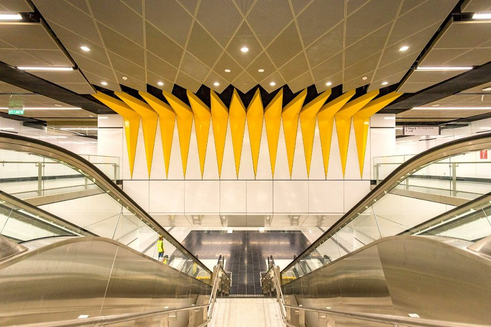 The ceiling above the escalator is decorated with 14-pointed star on the flag of Malaysia