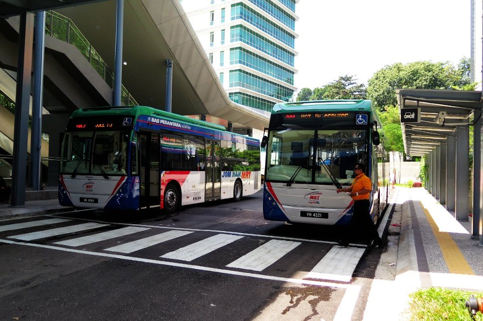 Feeder buses waiting at bus stop near entrance A