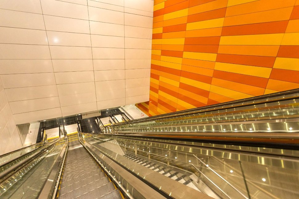 Escalator and stair access between levels at Cohrane station (Jul 2017)