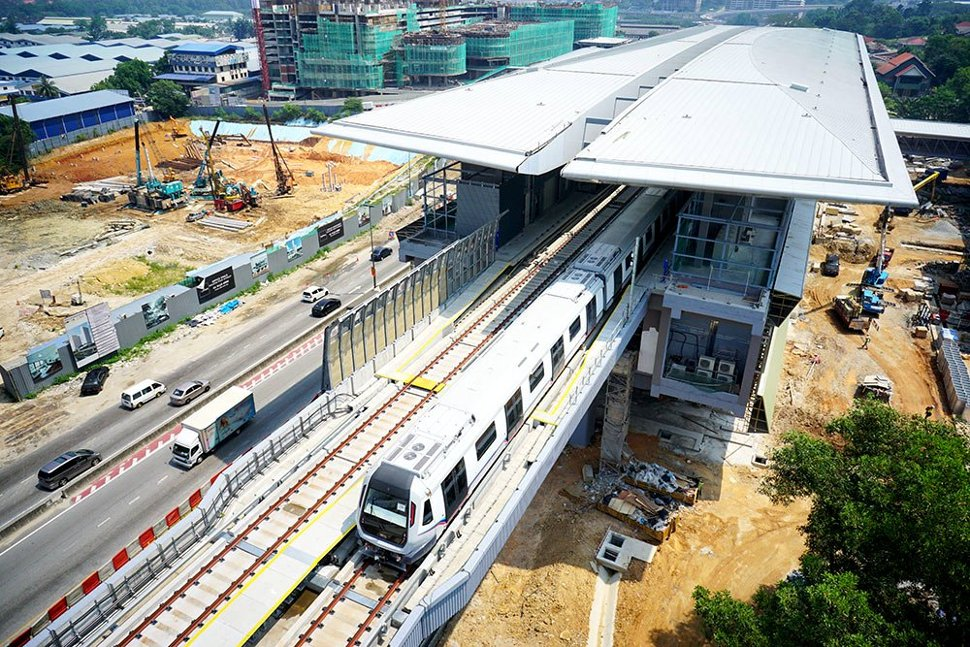 Aerial view of the trains undergoing testing on the completed guideway leaving the Kampung Selamat station. (Apr 2016)