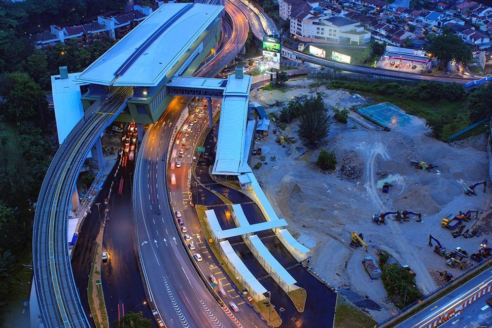 Evening aerial view of the Pusat Bandar Damansara Station and the lay-bys for feeder buses, taxis and private cars to drop-off and pick-up MRT commuters. (Sep 2016)