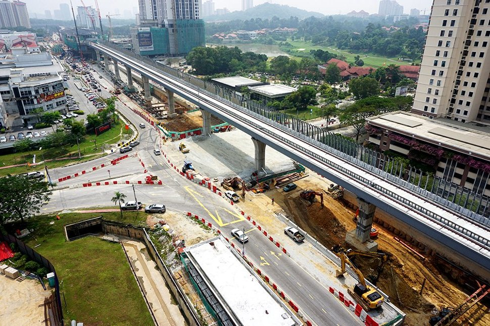 Aerial view of the MRT guideway with the construction of the Persiaran Mahagoni intersection underpass in progress. (Oct 2015)