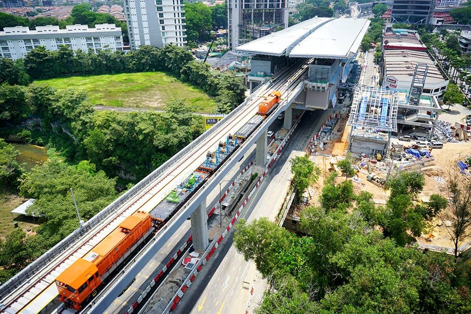 Locomotives transporting equipment on the completed guideway heading towards the Taman Tun Dr Ismail Station. (Apr 2016)