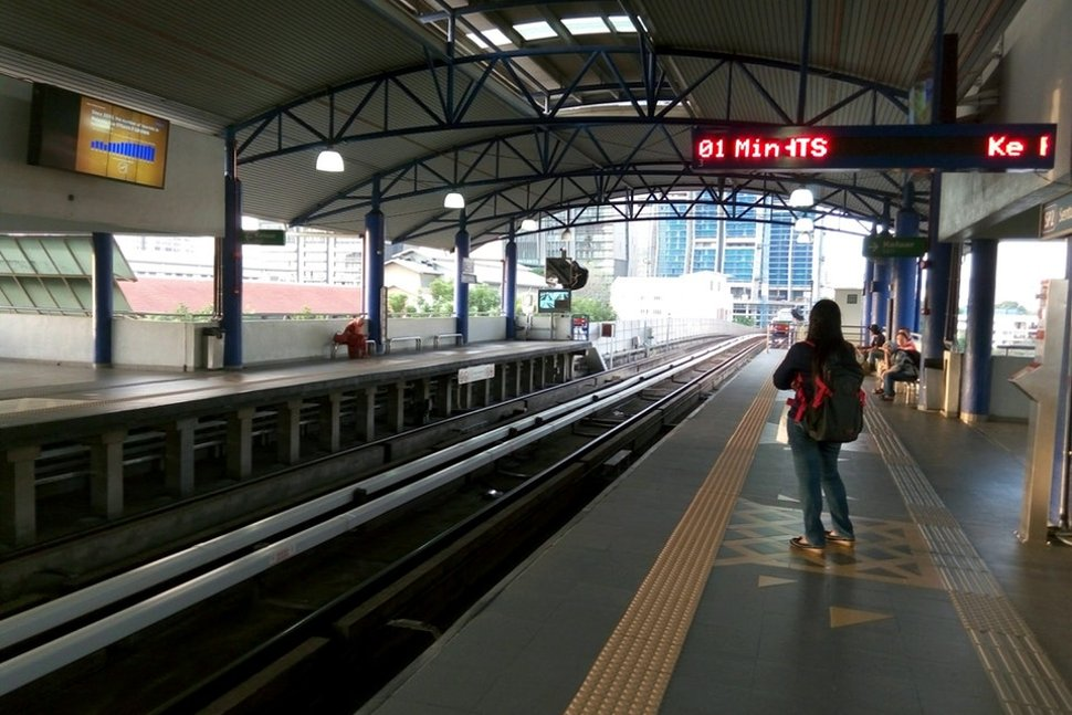 Commuters waiting for train at the platform