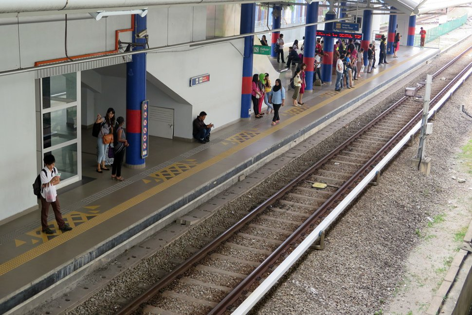 Commuters waiting at Tasik Selatan LRT station
