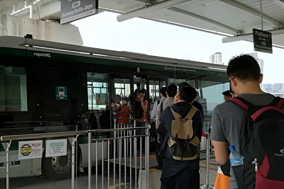 Passengers boarding the BRT bus at this integrated LRT / BRT station