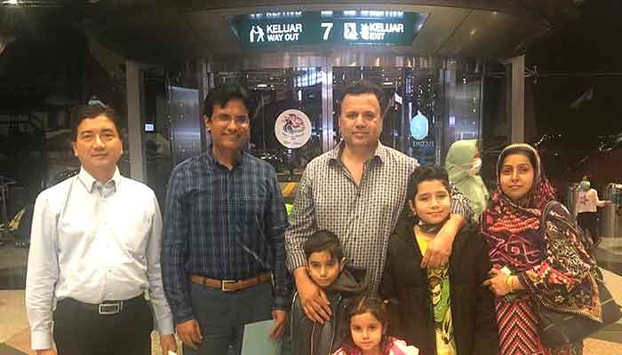 Naveed with his family at Kuala Lumpur airport. Photo Pak FO