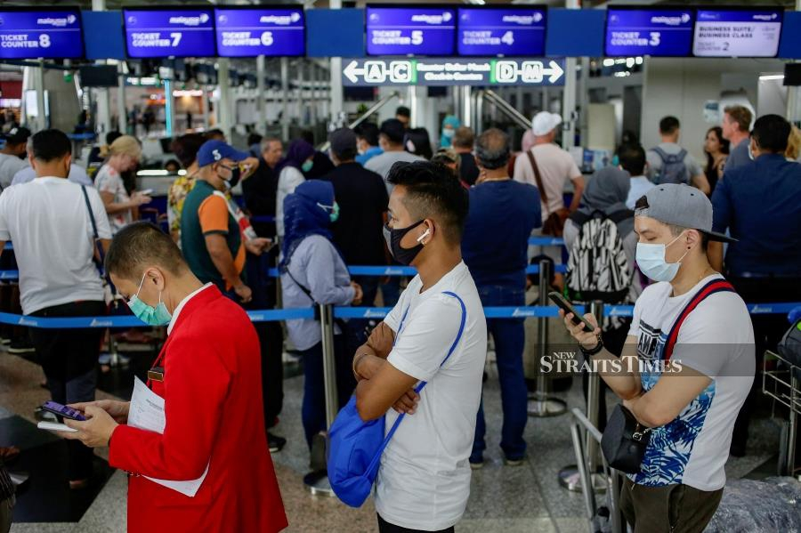 File Photo: Sabahans and Sarawakians returning from overseas to their home states via the Kuala Lumpur International Airport (KLIA) must first undergo quarantine in the peninsula. - NSTP/AIZUDDIN SAAD