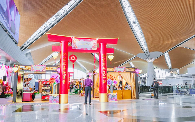 The Chinese New Year centrepiece at KLIA's main terminal is inspired by a Floating Garden with koi fish to symbolise luck and prosperity.