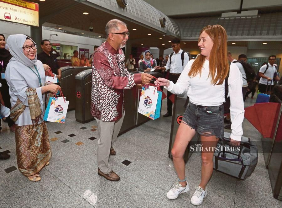 Deputy Tourism, Arts and Culture Minister Muhammad Bakhtiar Wan Chik presenting a goodie bag to a tourist at KL Sentral yesterday. NSTP/ZUNNUR AL SHAFIQ