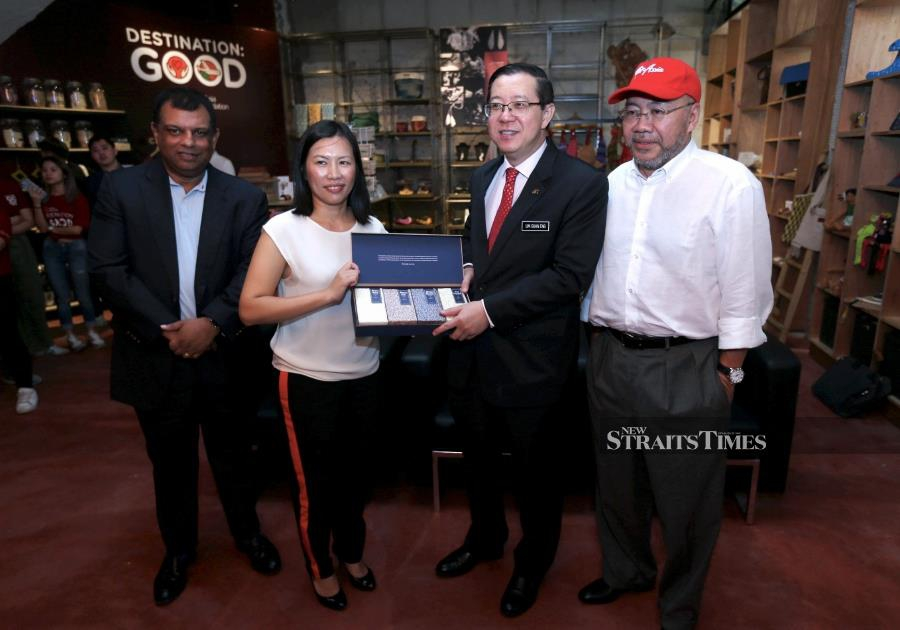 Finance Minister Lim Guan Eng (second from right), AirAsia Foundation executive director Yap Mun Ching (second from left), AirAsia Group executive chairman Datuk Kamarudin Meranum (right) and AirAsia Group chief executive officer Tan Sri Tony Fernandes at the launch of 'Destination GOOD' physical store in REXKL, Jalan Sultan, Kuala Lumpur.
