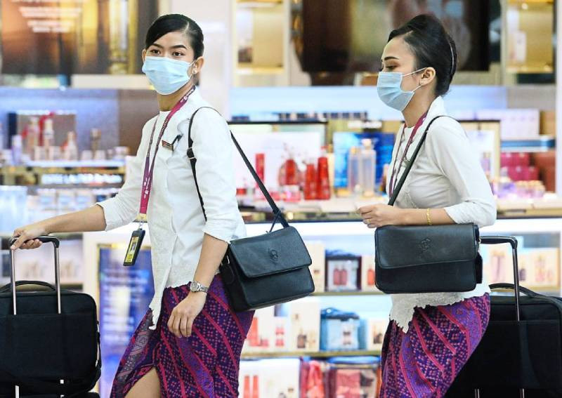 Healthcare is foremost: Stewardesses at KLIA wearing face masks amid fears over the spread of Covid-19. The Star/Asia News Network