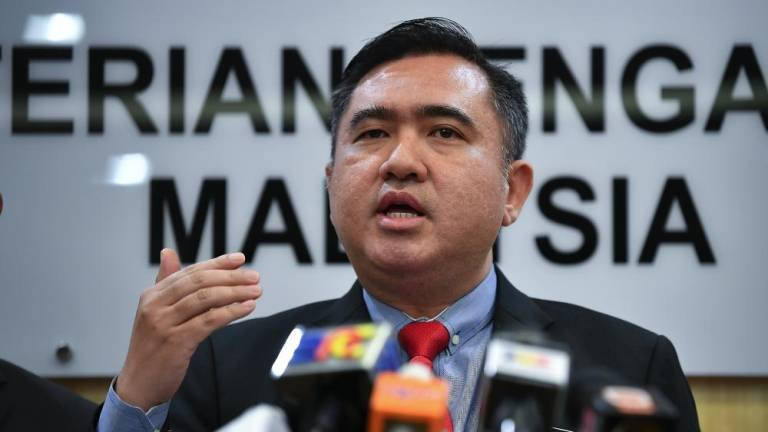 Transport Minister Anthony Loke Siew Fook speaks at a press conference at the Transport Ministry in Putrajaya. - Bernama