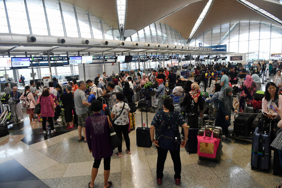 Passengers are seen at KLIA in Sepang August 22, 2019, during a systems outage. — Bernama pic