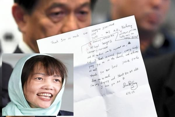 Honest thoughts: The letter written by Doan (inset) being held up by Teh during a press conference in Kuala Lumpur. — Bernama
