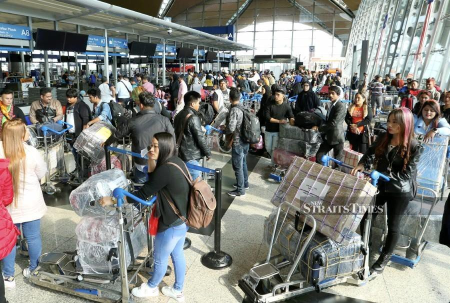 Passengers waiting at the Kuala Lumpur International Airport following the system glitch.
