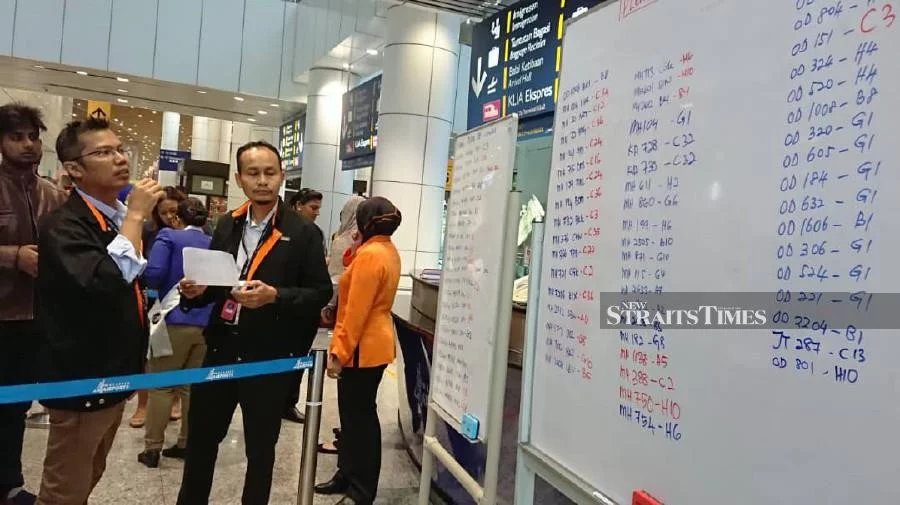 Airport Care Ambassador helping out with informing passengers at Kuala Lumpur International Airport. -NSTP/Courtesy of NST reader.