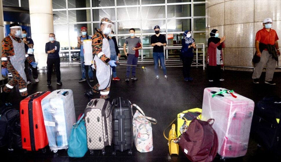 A team of firemen sanitising and disinfecting baggage of passengers who arrived at the Kuala Lumpur International Airport. They do this and more at no extra cost to travellers.