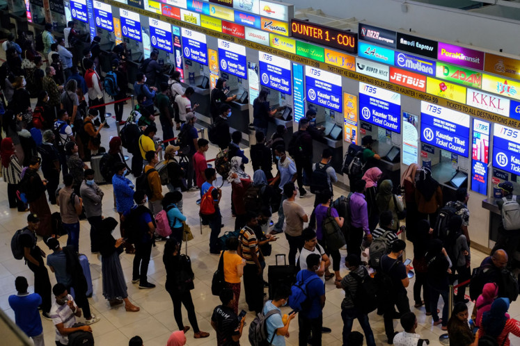 People line-up buy a ticket at the Terminal Bersepadu Selatan in Kuala Lumpur, Malaysia, on Tuesday, March. 17, 2020. (Bloomberg/Samsul Said)