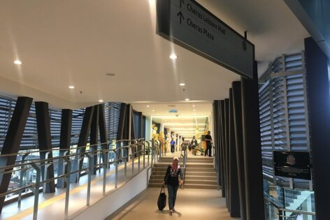 Pedestrian walkway connects the MRT station to the Leisure Mall shopping center