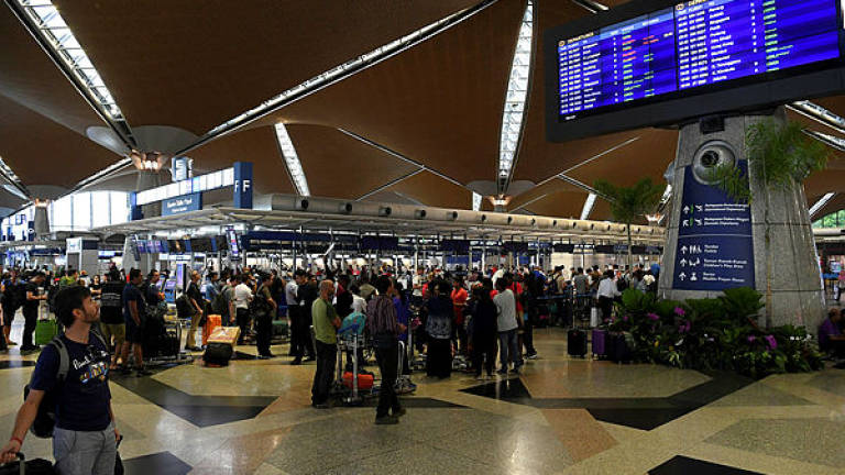 Passengers at the KLIA Departure Hall