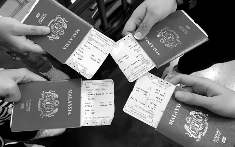 Four of the six Malaysians showing their passports and boarding passes. (Twitter user @reenzahari pic)