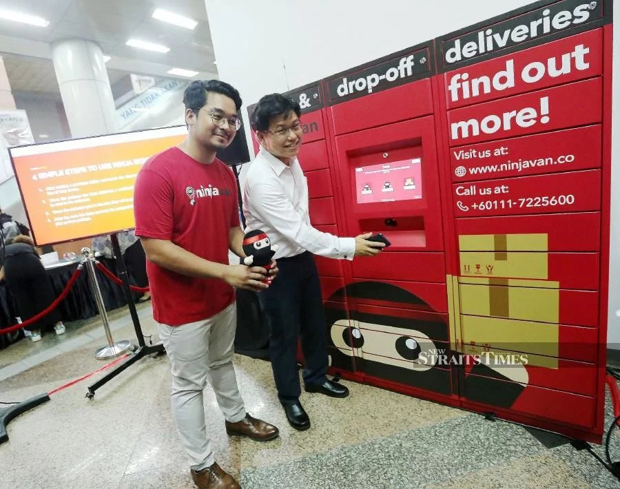 "Ninja Van's country head, Adzim Halim (right) and Prasarana Group chief operating officer (Strategy & Transformation), Ang Yoke Kee launching network of parcel collection lockers, also known as "" Ninja Box ', provides a convenient and safe alternative for millions of commuters to pick-up and drop-off their parcels at KL Sentral."