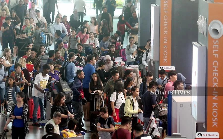 A balik kampung crowd seen lining up at the at klia2 ahead of the Hari Raya Aidilfitri holidays.
