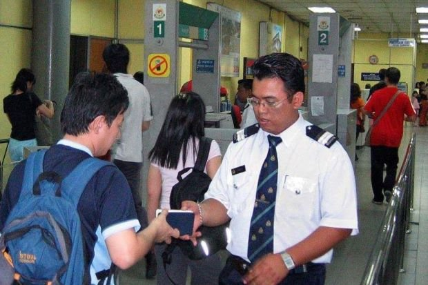 Officer checking document at the gate