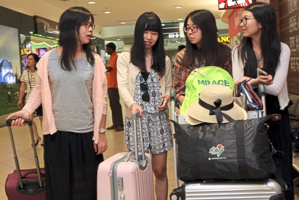 Tourists from China at Penang International Airport.